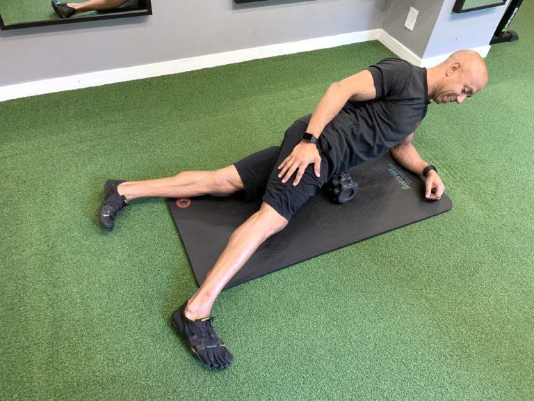 Adam Friedman Advanced Athletics Fitness Expert Demonstrates Rumble Roller Self Myofascial Massage For Mobility